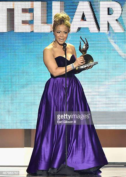 Singer Erica Campbell accepts an award onstage during the 30th annual Stellar Gospel Music Awards at the Orleans Arena on March 28 2015 in Las Vegas...