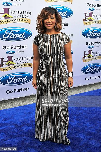 Singer Erica Campbell attends the 2014 Ford Neighborhood Awards Hosted By Steve Harvey at the Phillips Arena on August 9 2014 in Atlanta Georgia