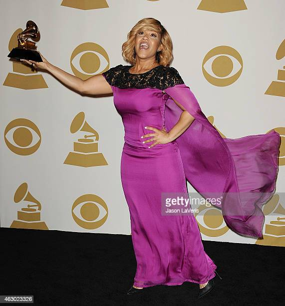 Singer Erica Campbell poses in the press room at the 57th GRAMMY Awards at Staples Center on February 8 2015 in Los Angeles California