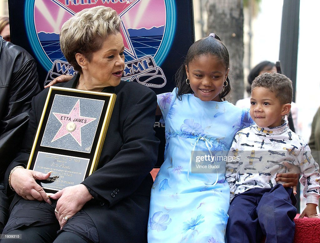 Singer Etta James displays her star with her grandchildren, Karissia and Savina James, during a ceremony honoring James on the Hollywood Walk of Fame April 18, 2003 in Hollywood, California.