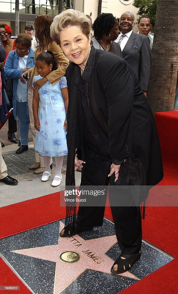 Singer Etta James stands over her star on the Hollywood Walk of Fame during a ceremony in her honor April 18, 2003 in Hollywood, California.