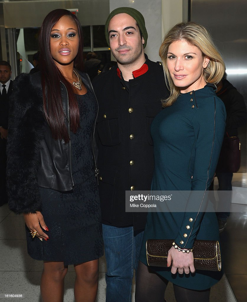 Singer Eve, Mohammed Al Turki and Hofit Golan pose at the Elie Tahari Fall 2013 fashion show presentation during Mercedes-Benz Fashion Week at The Studio at Lincoln Center on February 12, 2013 in New York City.