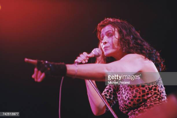 Singer Fabienne Shine wearing a leopard print top performs live on stage with French rock band Shakin' Street circa 1978