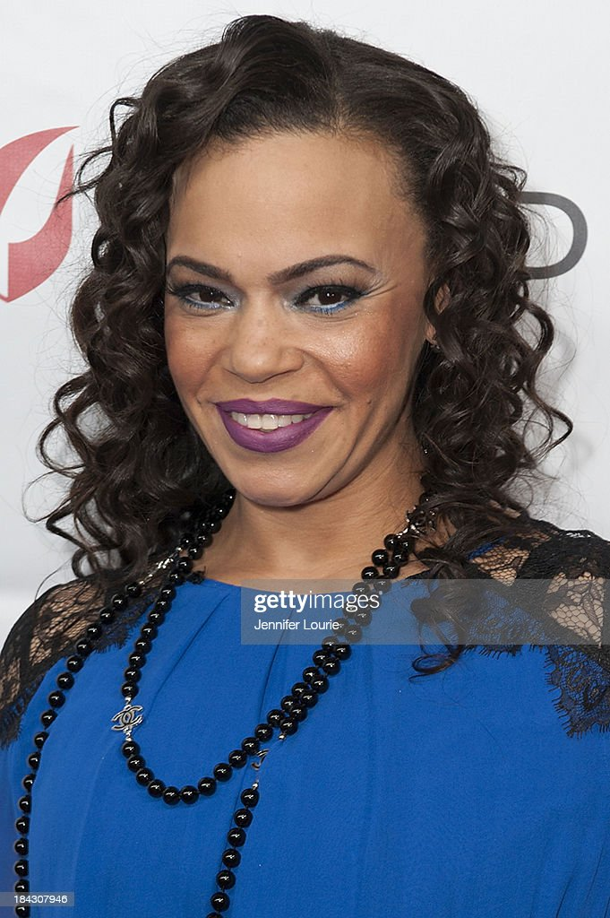 Singer <a gi-track='captionPersonalityLinkClicked' href=/galleries/search?phrase=Faith+Evans&family=editorial&specificpeople=203286 ng-click='$event.stopPropagation()'>Faith Evans</a> attends the 23rd Annual HIV/AIDS benefit concert DIVAS Simply Singing! at Club Nokia on October 12, 2013 in Los Angeles, California.