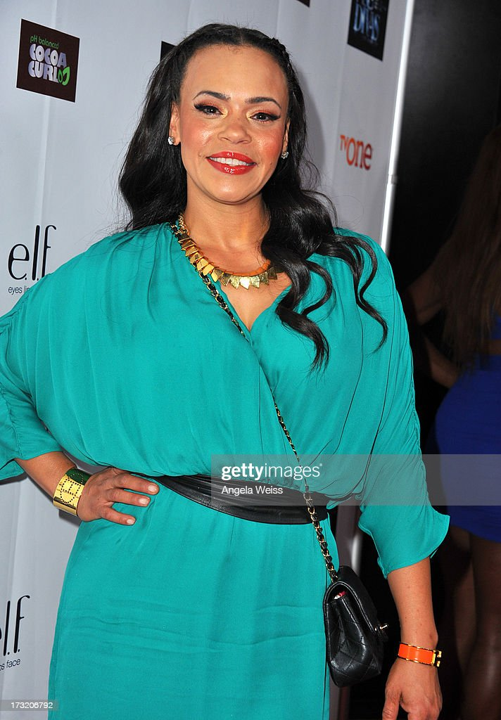 Singer <a gi-track='captionPersonalityLinkClicked' href=/galleries/search?phrase=Faith+Evans&family=editorial&specificpeople=203286 ng-click='$event.stopPropagation()'>Faith Evans</a> attends the 'R&B Divas LA' premiere event at The London on July 9, 2013 in West Hollywood, California.