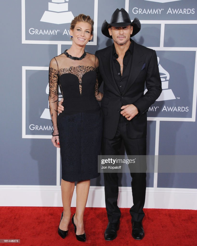 Singer <a gi-track='captionPersonalityLinkClicked' href=/galleries/search?phrase=Faith+Hill&family=editorial&specificpeople=175933 ng-click='$event.stopPropagation()'>Faith Hill</a> and husband Tim McGraw arrive at The 55th Annual GRAMMY Awards at Staples Center on February 10, 2013 in Los Angeles, California.