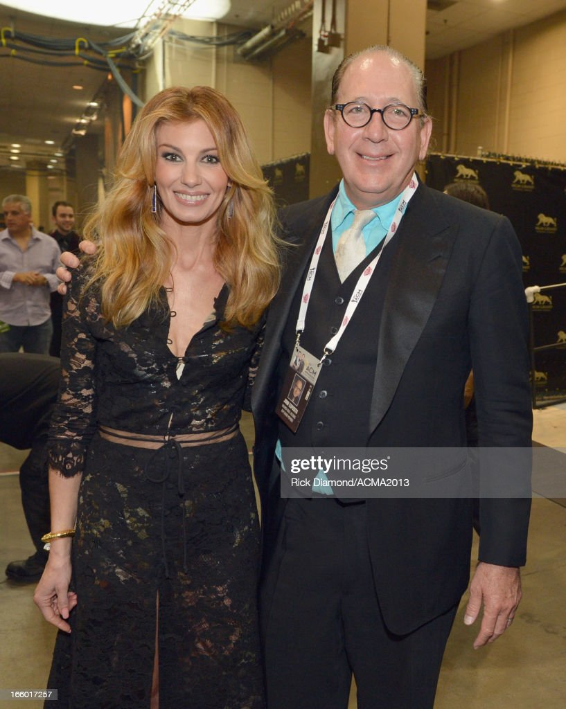 Singer Faith Hill (L) and President of Warner Music Nashville John Esposito attend the 48th Annual Academy of Country Music Awards at the MGM Grand Garden Arena on April 7, 2013 in Las Vegas, Nevada.