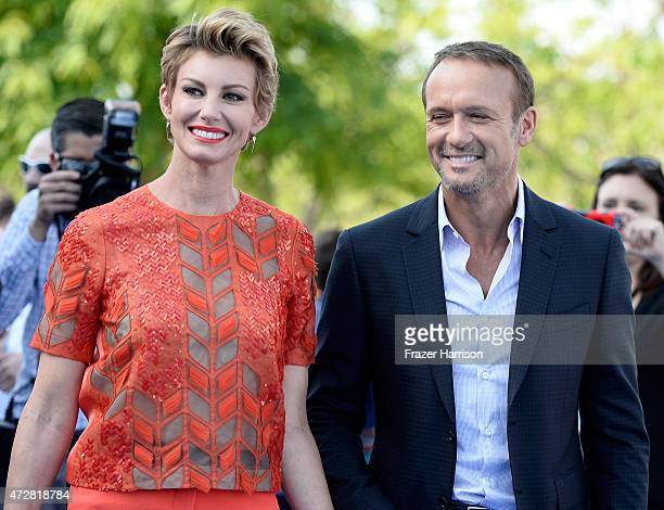 Singer Faith Hill and Tim McGraw attend the Premiere Of Disney's 'Tomorrowland' at AMC Downtown Disney 12 Theater on May 9 2015 in Anaheim California