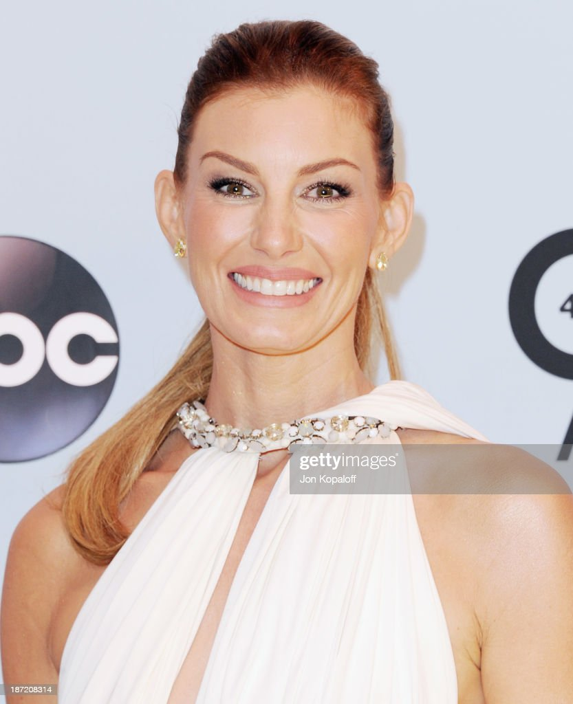 Singer <a gi-track='captionPersonalityLinkClicked' href=/galleries/search?phrase=Faith+Hill&family=editorial&specificpeople=175933 ng-click='$event.stopPropagation()'>Faith Hill</a> attends the 47th annual CMA Awards at the Bridgestone Arena on November 6, 2013 in Nashville, Tennessee.
