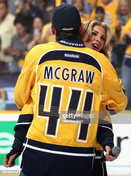 Singer Faith Hill gets a hug by Tim McGraw after the she sang the national anthem before the start of Game Six of the 2017 NHL Stanley Cup Final...
