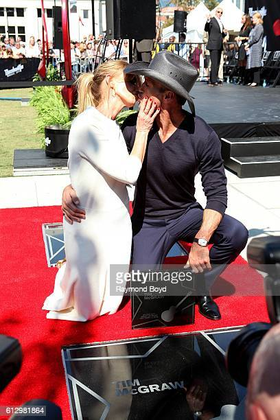 Singer Faith Hill kisses her husband Tim McGraw after Tim received his star on the Music City Walk of Fame in 'Walk of Fame Park' in Nashville...