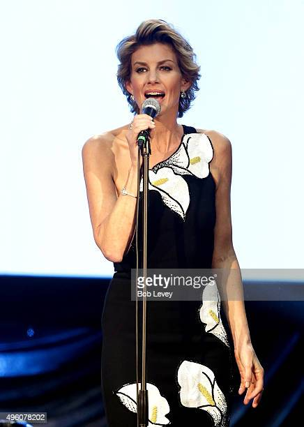 Singer Faith Hill performs onstage at the UNICEF Audrey Hepburn Society Ball honoring former first lady Barbara Bush at the Hilton Americas Hotel on...