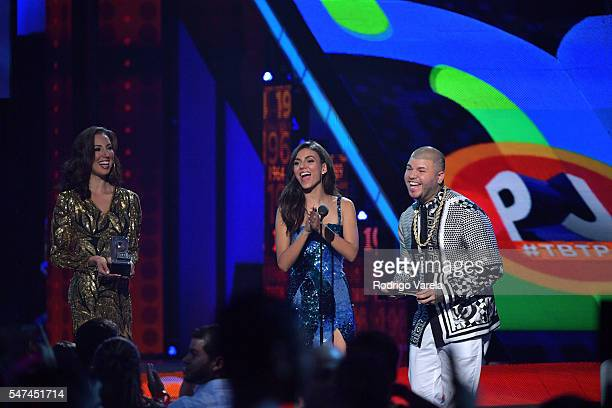 Singer Farruko recieves award onstage at the Univision's 13th Edition Of Premios Juventud Youth Awards at Bank United Center on July 14 2016 in Miami...