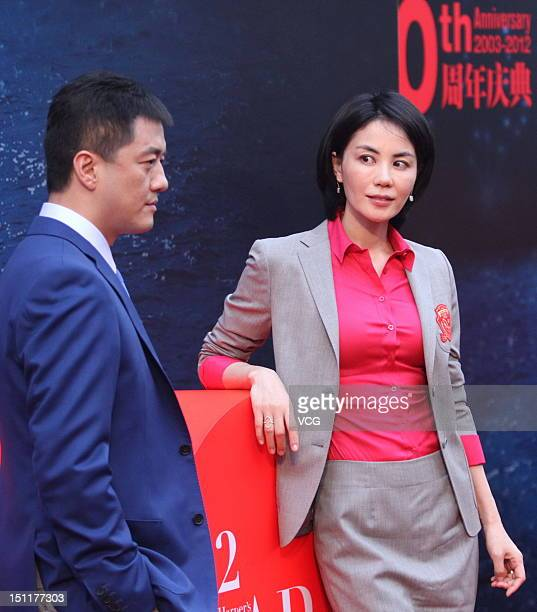 Singer Faye Wong and her husband Li Yapeng attend the 2012 Bazaar Charity Night at 798 Art Zone on September 1 2012 in Beijing China