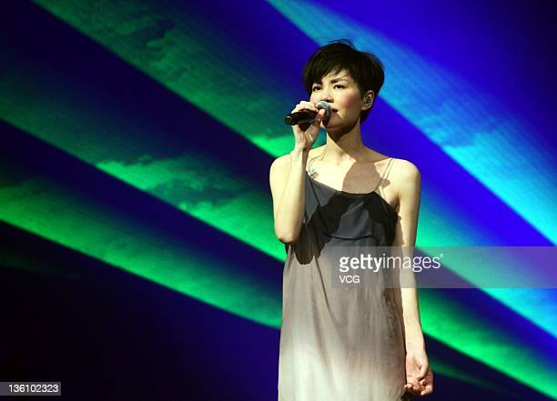 Singer Faye Wong performs on the stage at Xi'an Qujiang International Conference and Exhibition Center on December 23 2011 in Xi An China