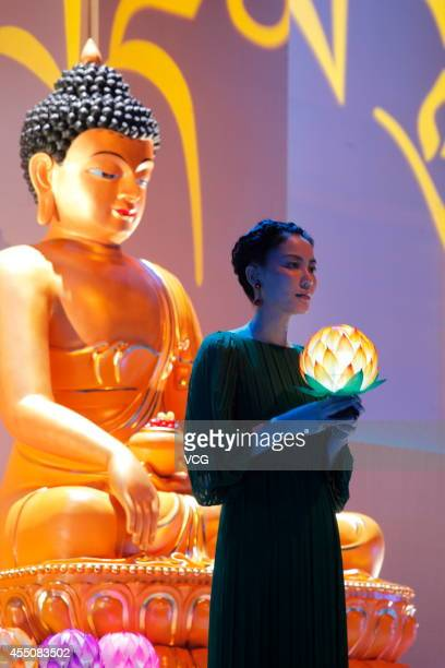 Singer Faye Wong performs on the stage during the 10th Anniversary Hong Kong Kagyu Monlam on September 9 2014 in Hong Kong China