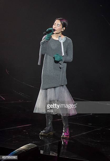 Singer Faye Wong performs onstage during her concert 'Faye's Moments Live 2016' at Shanghai MercedesBenz Arena in December 30 2016 in Shanghai China