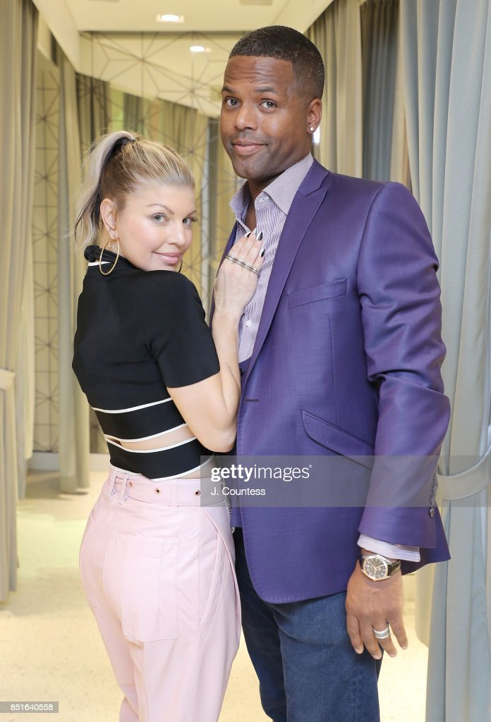 Singer Fergie and A. J. Calloway pose for a photo during Fergie's visit to 'Extra' at their New York Studios at H&M Times Square on September 22, 2017 in New York City.
