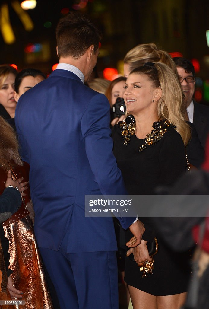 Singer Fergie and actor Josh Duhamel arrive at the premiere of Relativity Media's 'Safe Haven' at TCL Chinese Theatre on February 5, 2013 in Hollywood, California.