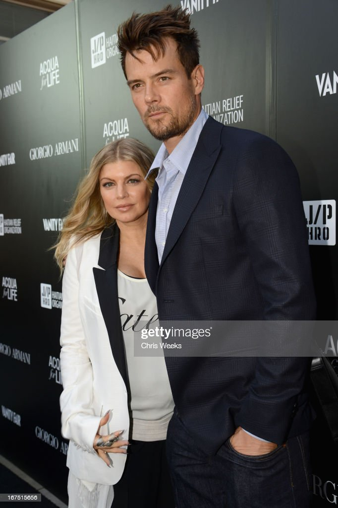 Singer Fergie (L) and actor <a gi-track='captionPersonalityLinkClicked' href=/galleries/search?phrase=Josh+Duhamel&family=editorial&specificpeople=208740 ng-click='$event.stopPropagation()'>Josh Duhamel</a> attend Giorgio Armani Paris Photo LA Acqua #3 at Paramount Studios on April 25, 2013 in Los Angeles, California.