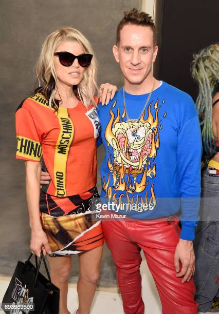 Singer Fergie and designer Jeremy Scott pose backstage at Moschino Spring/Summer 18 Menswear and Women's Resort Collection at Milk Studios on June 8...