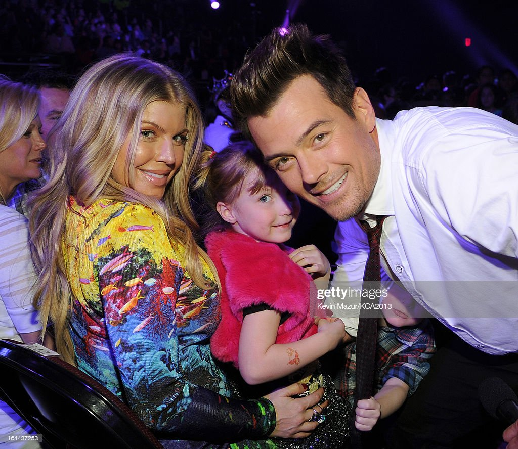 Singer Fergie (L) and host <a gi-track='captionPersonalityLinkClicked' href=/galleries/search?phrase=Josh+Duhamel&family=editorial&specificpeople=208740 ng-click='$event.stopPropagation()'>Josh Duhamel</a> attend Nickelodeon's 26th Annual Kids' Choice Awards at USC Galen Center on March 23, 2013 in Los Angeles, California.