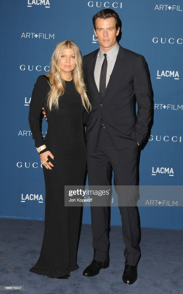 Singer Fergie and husband actor <a gi-track='captionPersonalityLinkClicked' href=/galleries/search?phrase=Josh+Duhamel&family=editorial&specificpeople=208740 ng-click='$event.stopPropagation()'>Josh Duhamel</a> arrive at LACMA 2013 Art + Film Gala at LACMA on November 2, 2013 in Los Angeles, California.