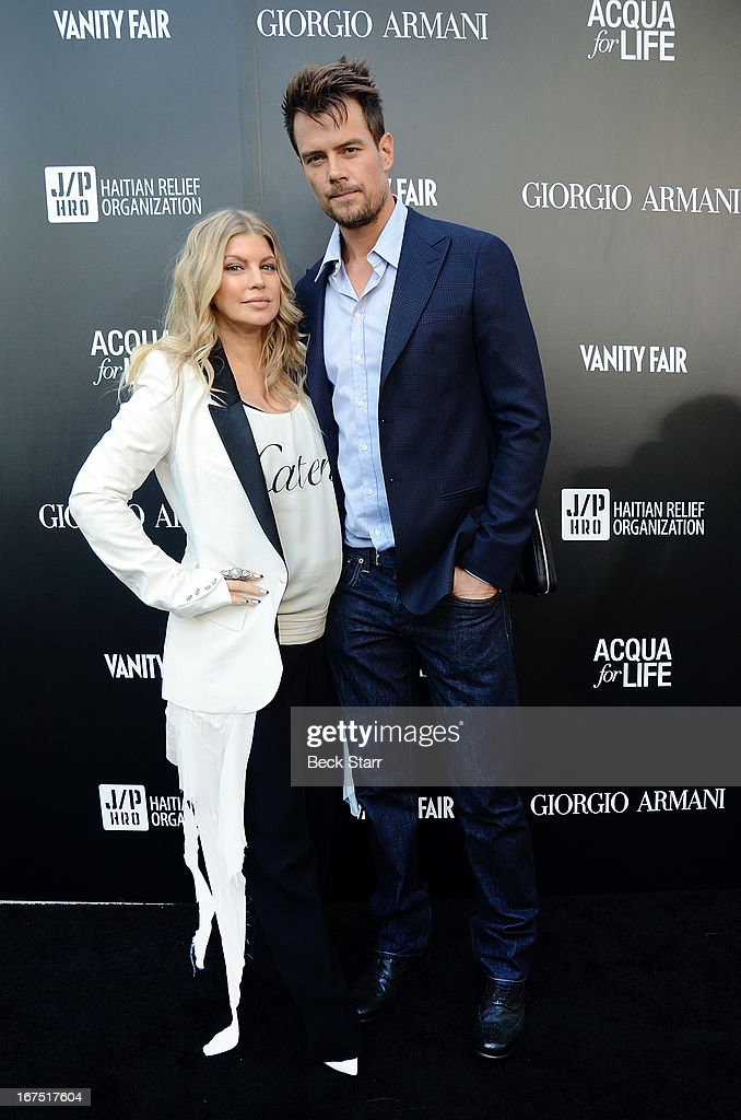 Singer Fergie and husband actor <a gi-track='captionPersonalityLinkClicked' href=/galleries/search?phrase=Josh+Duhamel&family=editorial&specificpeople=208740 ng-click='$event.stopPropagation()'>Josh Duhamel</a> arrive at the Giorgio Armani pary to celebrate Paris Photo Los Angeles Vernissage opening night at Paramount Studios on April 25, 2013 in Hollywood, California.
