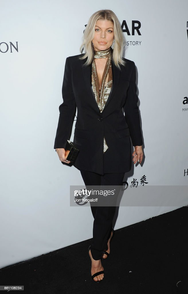 Singer Fergie arrives at amfAR Los Angeles 2017 at Ron Burkleâs Green Acres Estate on October 13, 2017 in Beverly Hills, Californi
