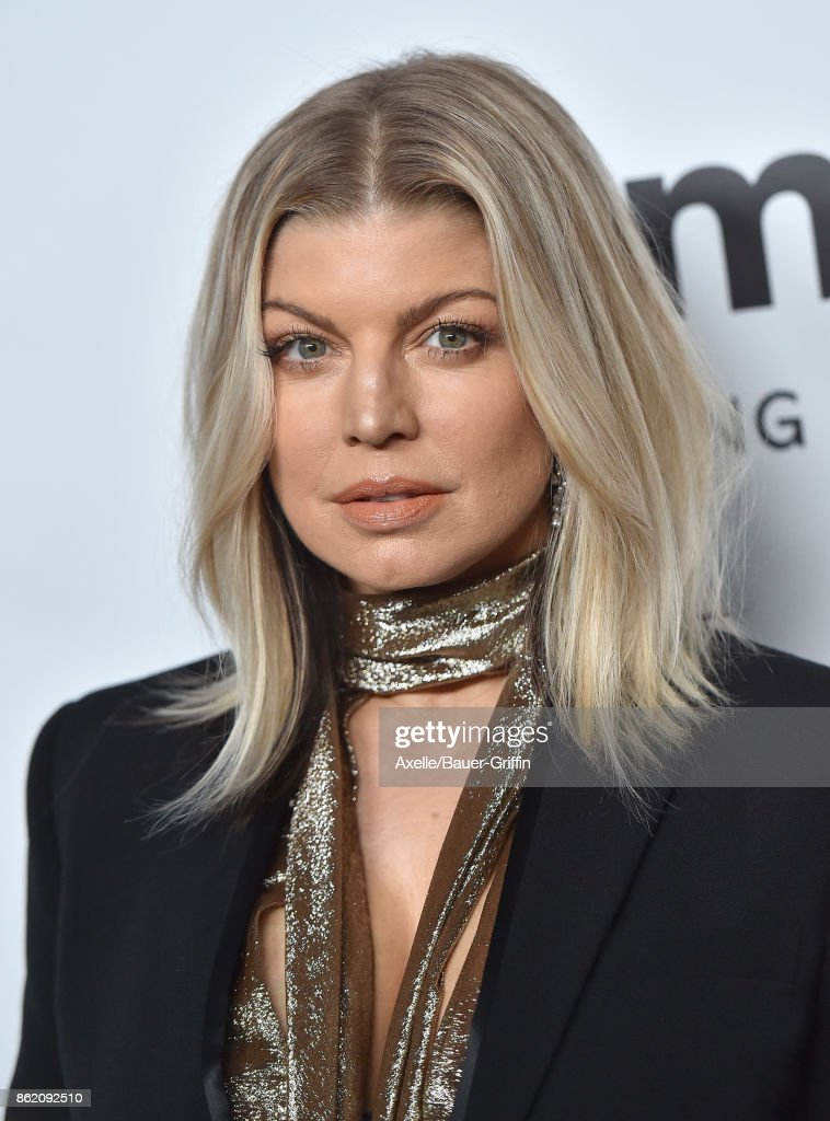 Singer Fergie arrives at amfAR Los Angeles 2017 at Ron Burkle's Green Acres Estate on October 13, 2017 in Beverly Hills, California.