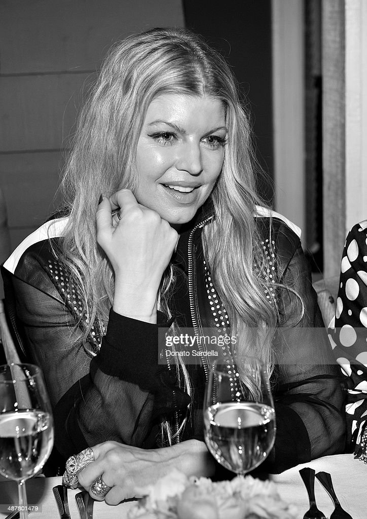 Singer Fergie attends a private dinner in honor of Fausto Puglisi of Emanuel Ungaro hosted by Barneys New York at Chateau Marmont on May 1, 2014 in Los Angeles, California.