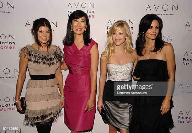 Singer Fergie Chairman and Chief Executive Officer of Avon Products Andrea Jung actress Reese Witherspoon and Courteney Cox walk the red carpet...