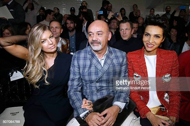 Singer Fergie Christian Louboutin and Farida Khelfa attend the Jean Paul Gaultier Spring Summer 2016 show as part of Paris Fashion Week on January 27...