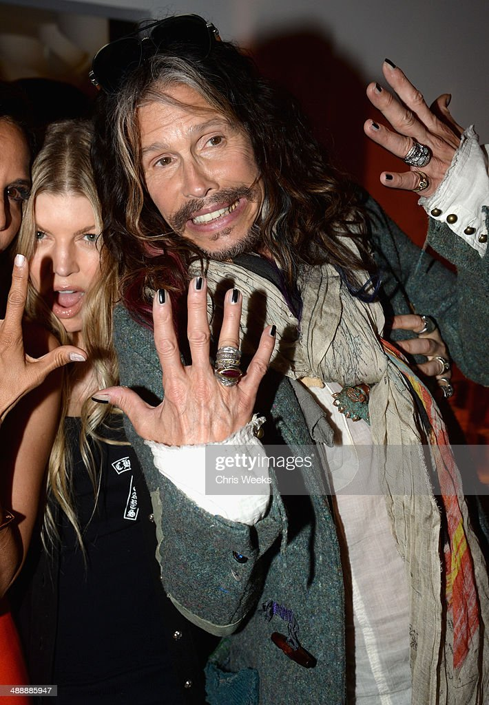 Singer Fergie Duhamel (L) and musician Steven Tyler attend Chrome Hearts & Kate Hudson Host Garden Party To Celebrate Collaboration at Chrome Hearts on May 8, 2014 in Los Angeles, California.