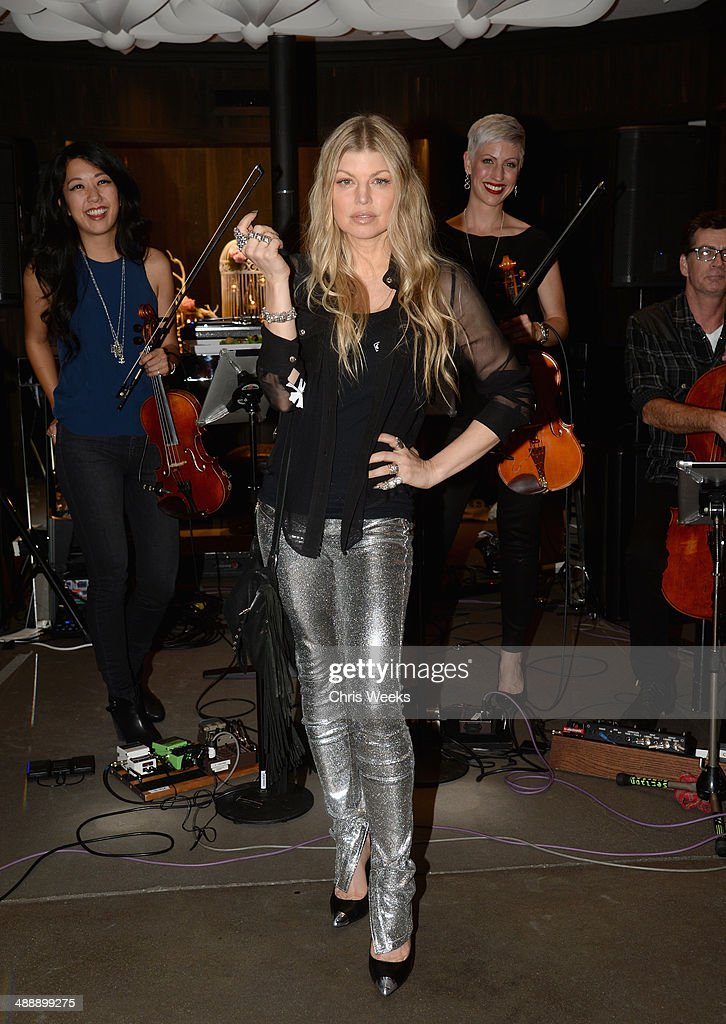Singer Fergie Duhamel (C) and (L-R) musicians Daphne Chen, Lauren Chipman and Richard Dodd of The Section Quartet at Chrome Hearts & Kate Hudson Host Garden Party To Celebrate Collaboration at Chrome Hearts on May 8, 2014 in Los Angeles, California.