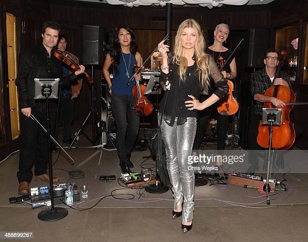 Singer Fergie Duhamel and musicians Eric Gorfain Daphne Chen Lauren Chipman and Richard Dodd of The Section Quartet at Chrome Hearts Kate Hudson Host...