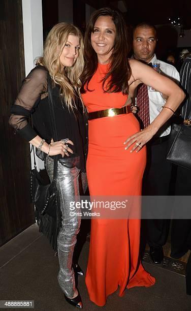 Singer Fergie Duhamel and owner/designer of Chrome Hearts Laurie Lynn Stark attend Chrome Hearts Kate Hudson Host Garden Party To Celebrate...