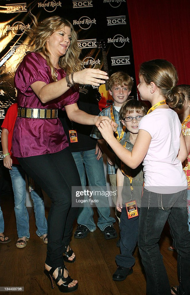 Singer Fergie greets young fans at a check presentation for <a gi-track='captionPersonalityLinkClicked' href=/galleries/search?phrase=Joe+DiMaggio&family=editorial&specificpeople=93596 ng-click='$event.stopPropagation()'>Joe DiMaggio</a> Children's Hospital at the Hard Rock Cafe at the Seminole Hard Rock Hotel and Casino on September 26, 2008 in Hollywood, Florida.