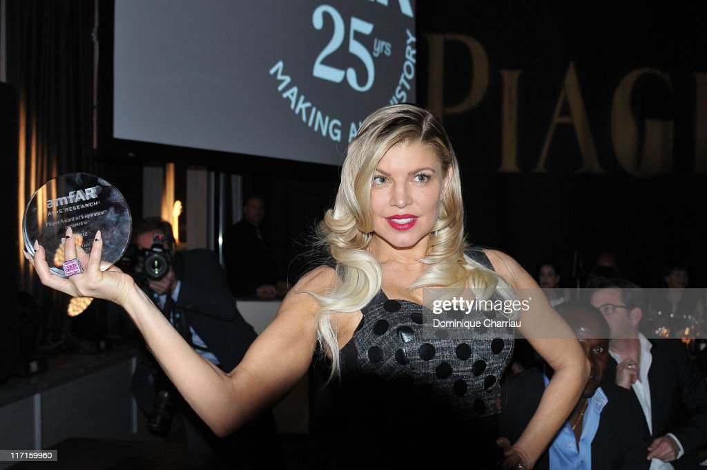 Singer Fergie is seen at the auction during the amfAR Inspiration Gala at Pavillon Gabriel on June 23, 2011 in Paris, France. (Photo by Dominique Charriau/WireImage) PARIS, FRANCE - JUNE 23: Singer Fergie is seen at the auction during the amfAR Inspiration Gala at Pavillon Gabriel on June 23, 2011 in Paris, France.