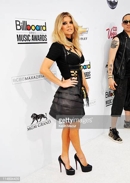 Singer Fergie of Black Eyed Peas arrives at the 2011 Billboard Music Awards at the MGM Grand Garden Arena May 22 2011 in Las Vegas Nevada