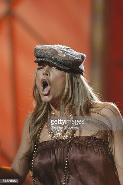 Singer Fergie of Black Eyed Peas performs at the taping of the 6th Annual 'A Home for the Holidays' on December 4 2004 at Ren Mar Studios in Los...