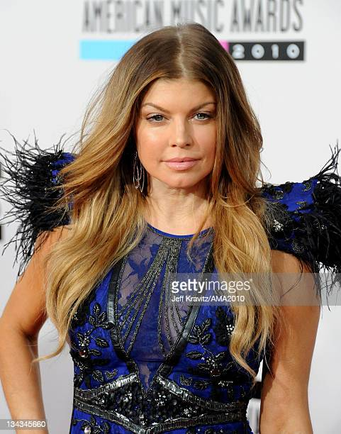 Singer Fergie of The Black Eyed Peas arrives at the 2010 American Music Awards at Nokia Theatre LA Live on November 21 2010 in Los Angeles California