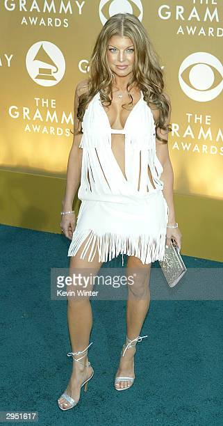 Singer Fergie of the Black Eyed Peas arrives at the 46th Annual Grammy Awards held at the Staples Center on February 8 2004 in Los Angeles California