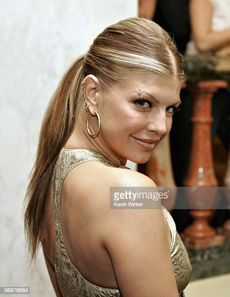 Singer Fergie of the Black Eyed Peas poses during the EIF's Women's Cancer Research Fund honoring Melissa Etheridge at Saks Fifth Avenue's...