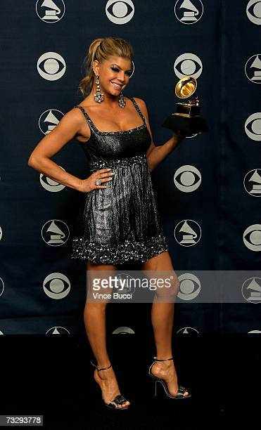 Singer Fergie of the Black Eyed Peas poses with her Grammy for Best Pop Performance By a Duo or Group with Vocal for 'My Humps' in the press room at...
