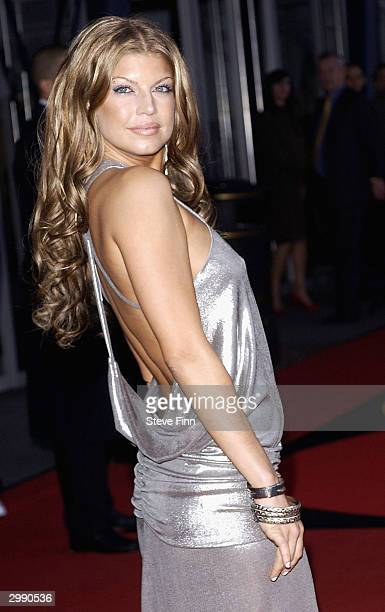 Singer Fergie of the rap group Black Eyed Peas arrives at the 'Brit Awards 2004' at Earls Court 2 on February 17 2004 in London Black Eyed Peas are...