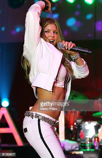 Singer Fergie performs at Christian Audigier's 50th birthday bash on May 23 2008 at the Peterson Automotive Museum in Los Angeles California