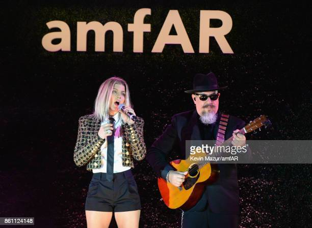 Singer Fergie performs onstage during the amfAR Gala Los Angeles 2017 at Ron Burkle's Green Acres Estate on October 13 2017 in Beverly Hills...