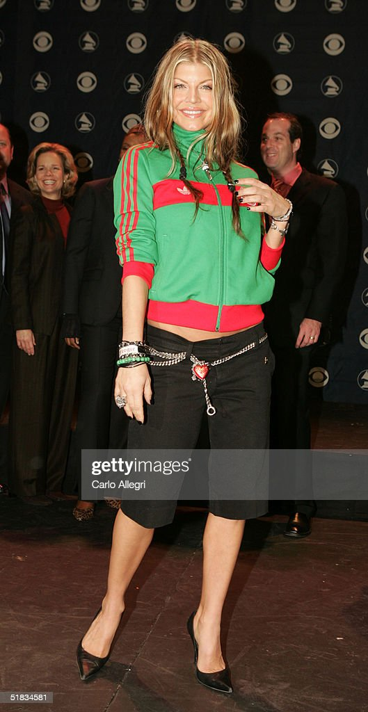 Singer Fergie poses for photos after the nominations for the 47th Annual GRAMMY Awards at The Music Box December 7 2004 in Hollywood California The...