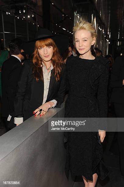 Singer Florence Welch and actress Carey Mulligan both wearing Prada attend Catherine Martin And Miuccia Prada Dress Gatsby Opening Cocktail on April...